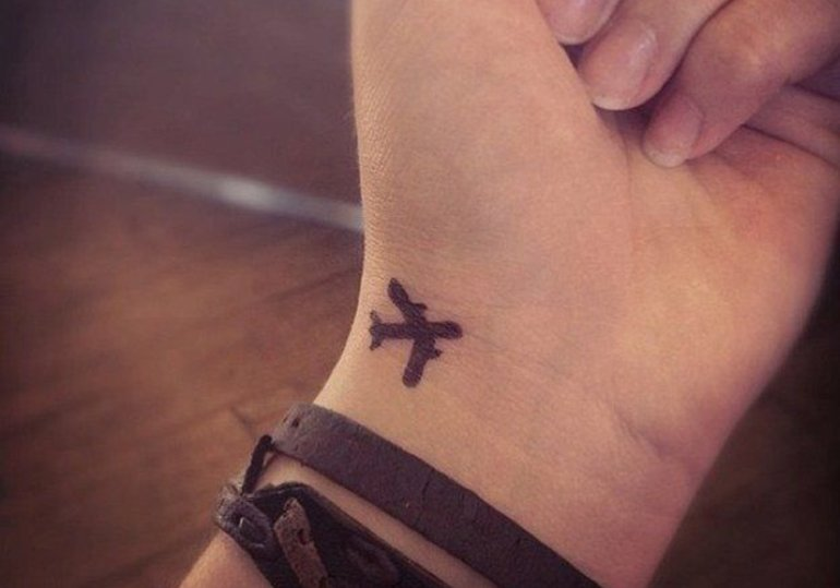 plane-tattoo-on-wrist